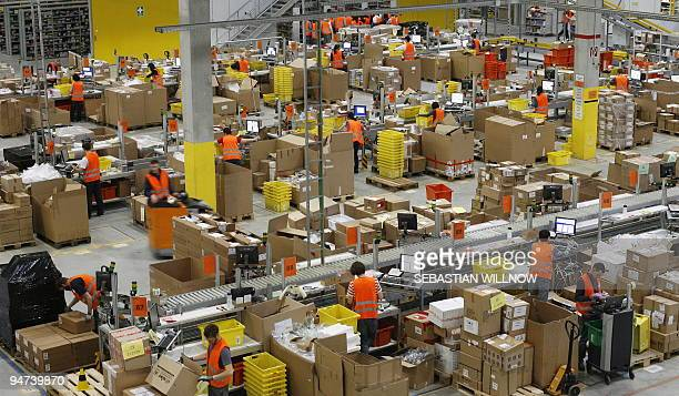 Workers go about their business at the online retailer Amazon's distribution centre in the eastern German city of Leipzig on December 11 2009 AFP...