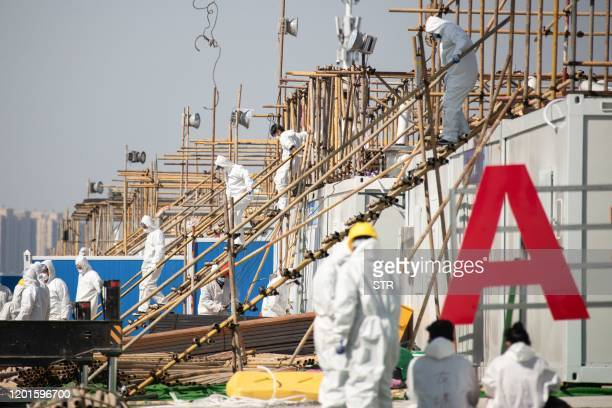 Workers go about their duties at a section of the Leishenshan Hospital the newlybuilt makeshift hospital for novel coronavirus patients in Wuhan in...