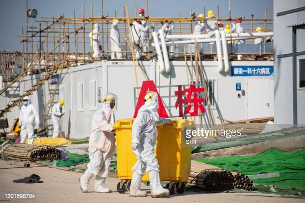 Workers go about their duties at a section of the Leishenshan Hospital, the newly-built makeshift hospital for novel coronavirus patients, in Wuhan...