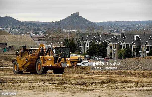 Workers grade large amounts of earth which will become apartments near the new Promenade shopping center on April 28 2016 in Castle Rock Colorado The...