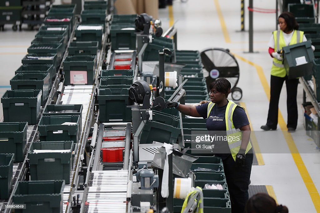 Workers handle items along the assembly line in the giant semi-automated distribution centre where the company's partners process the online orders for the John Lewis department store on January 3, 2013 in Milton Keynes, England. John Lewis has published their sales report for the five weeks prior December 29, 2012 which showed online sales had increased by 44.3 per cent over the same period in 2011. Purchases from their website Johnlewis.com now account for one quarter of all John Lewis business.