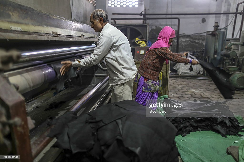 Workers handle sheets of dyed leather at the Jalandhar Leather Pvt tannery in Jalandhar Punjab India on Saturday Jan 21 2017 India`s 51 million micro.