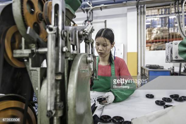 A workers handles a caster wheel at a factory operated by the Guangdong Shiyi Furniture Co in Foshan China on Tuesday Feb 28 2017 Startup EDeodar a...