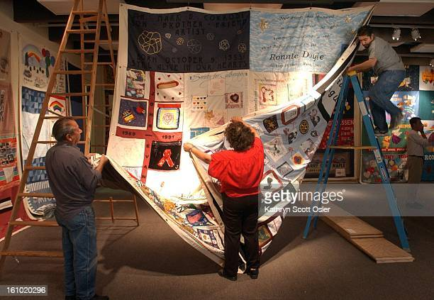 Workers hang a panel of the AIDS Memorial Quilt at the Sangre de Cristo Arts and Conference Center in Pueblo Hosted by the Southern Colorado AIDS...