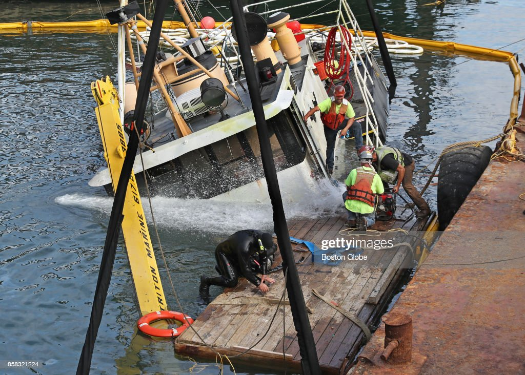 Workers haul up a 65-foot boat loaded with up to 250 gallons