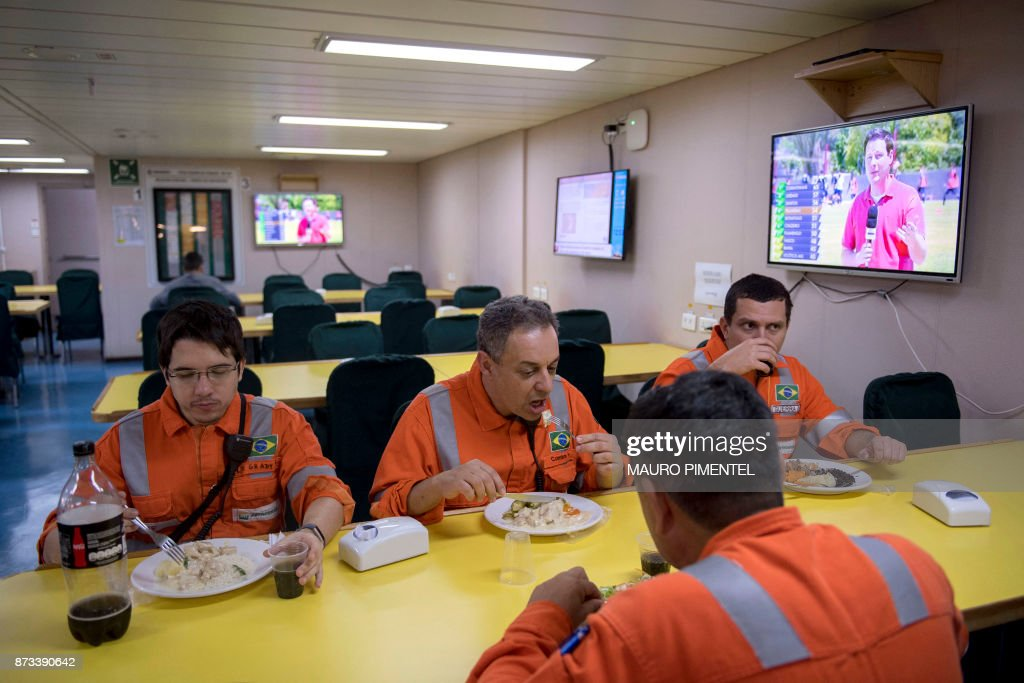 Workers Have A Meal At The Canteen Of The Floating Production Storage And  Offloading Vessel (