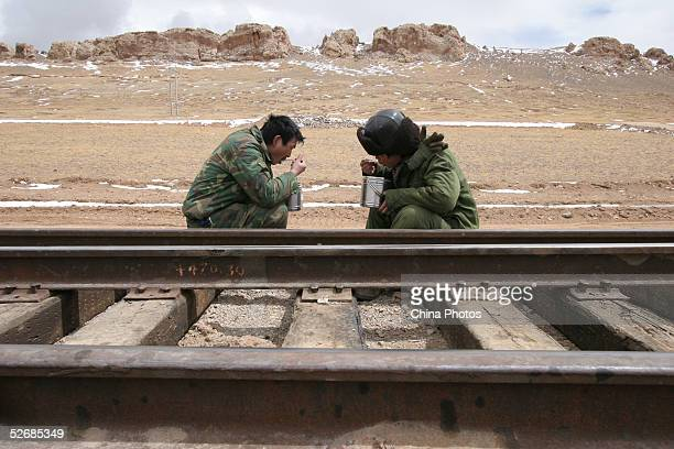 Workers have lunch at the construction site of the 2040km long QinghaiTibet Railway at an altitude of 4900 meters outside of Lhasa April 22 2005 in...