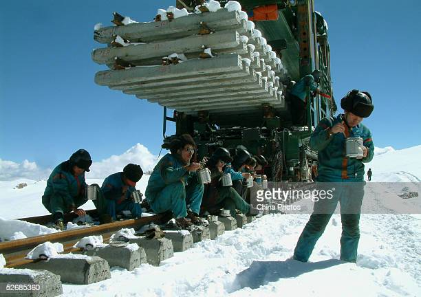 Workers have lunch at the construction site of the 2040km long QinghaiTibet Railway at an altitude of 4900m outside of Lhasa April 22 2005 in Amdo...
