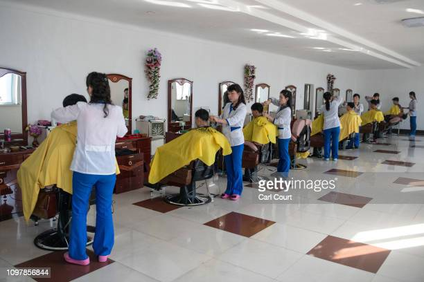 Workers have their hair cut in a salon in Hungnam Fertilizer Complex on February 04 2019 in Hamhung North Korea US President Donald Trump and North...