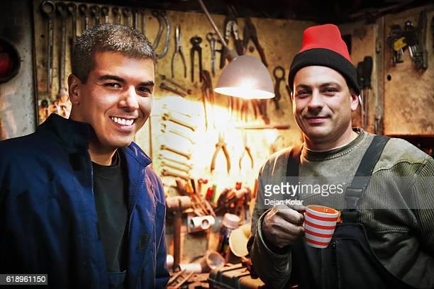 Workers having a coffee break at Vintage Auto Repair Shop.