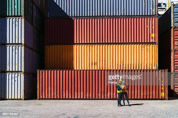 workers having discussion against cargo containers - container stock pictures, royalty-free photos & images