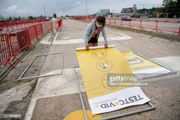 Workers help build a large coronavirus test village on Spoor Oost - Borgerhout where 500 to 4,000 test samples can be taken daily, on August 3, 2020...