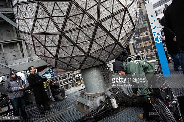 Workers help test the Times Square crystal ball one last time before tomorrow night's New Year's Eve celebration on December 30 2014 in New York City...