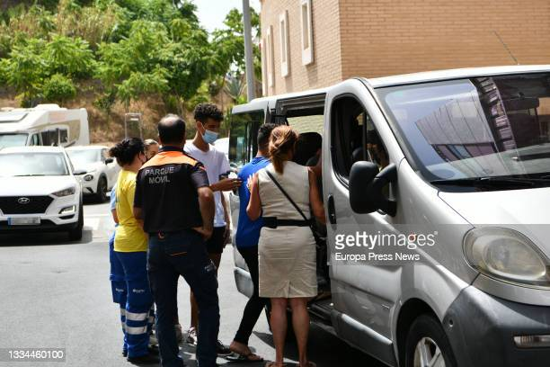 Workers help three of the Moroccan minors at the gates of the court after filing a complaint requesting habeas corpus minutes before being...