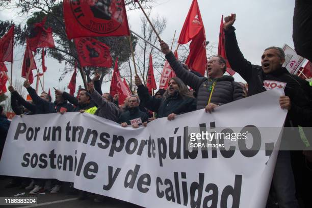 Workers hold a banner and flags while shouting slogans during the demonstration. EMT workers protest supported by Metro and taxi workers. The bus...