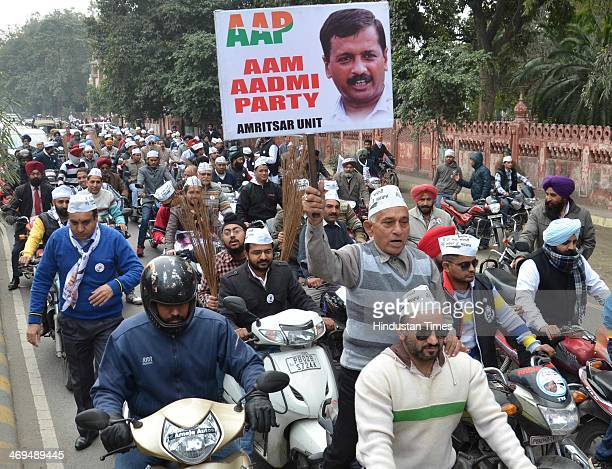AAP workers hold a Jhadu Chalao Yatra on February 15 2014 in Amritsar India On Friday evening Arvind Kejriwal announced his resignation over the...