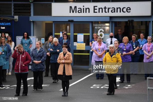 NHS workers hold a minute's silence outside the main entrance of Derriford Hospital on April 28 2020 in Plymouth United Kingdom The moment of silence...