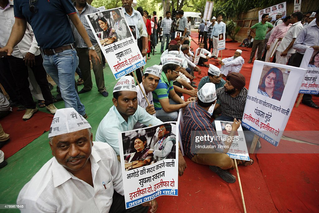 Aap protest against the sushma swaraj and other bjp leaders at aap workers hold placards during a protest demanding the resignation of the union minister smriti irani sciox Images
