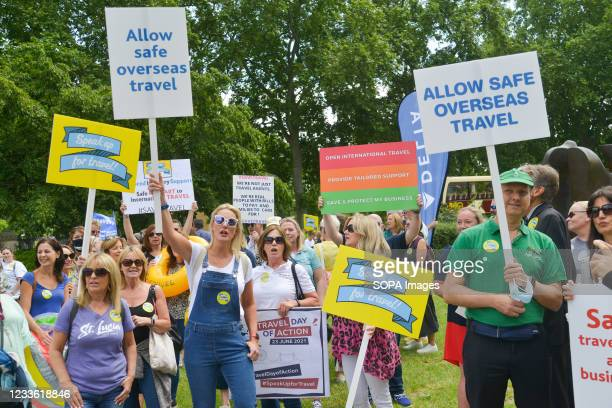 Workers hold placards during the demonstration. Travel Industry workers gathered at Westminster to demonstrate the lack of government support and...
