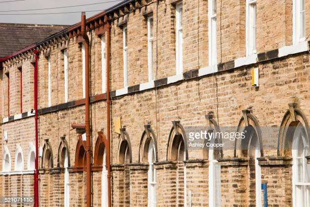 workers houses near salts mill in saltaire, yorkshire, uk. - philanthropist stock pictures, royalty-free photos & images