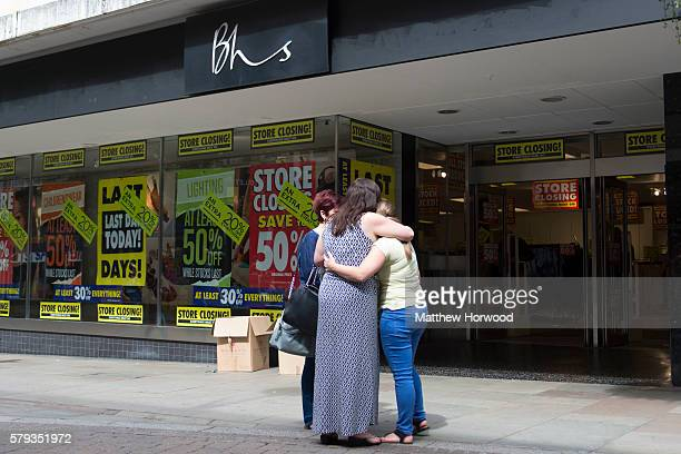 Workers hug outside the BHS store on Commercial Street on July 23 2016 in Newport Wales The store is one of 20 stores across the UK to close today...