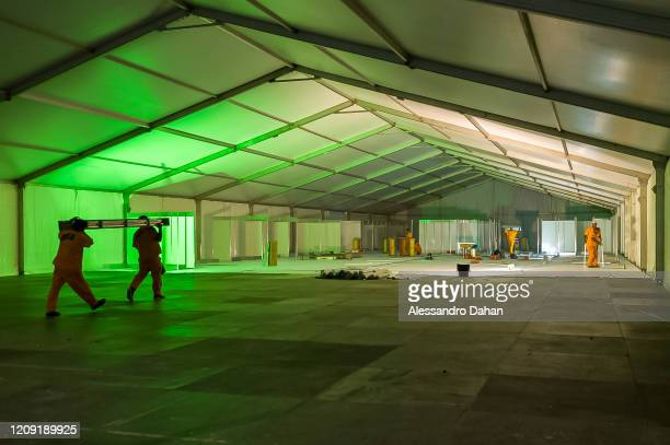 Workers in a field hospital under construction in Riocentro Convention Center on April 05 2020 in Rio de Janeiro Brazil The facility is being set up...