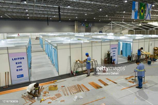 Workers in a field hospital under construction in Riocentro Convention Center on April 03 2020 in Rio de Janeiro Brazil The facility is being set up...