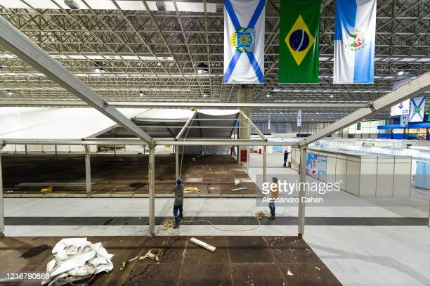 Workers in a field hospital under construction in Riocentro Convention Center on April 03, 2020 in Rio de Janeiro, Brazil. The facility is being set...