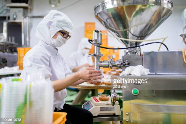 Workers in a food processing factory packaging food