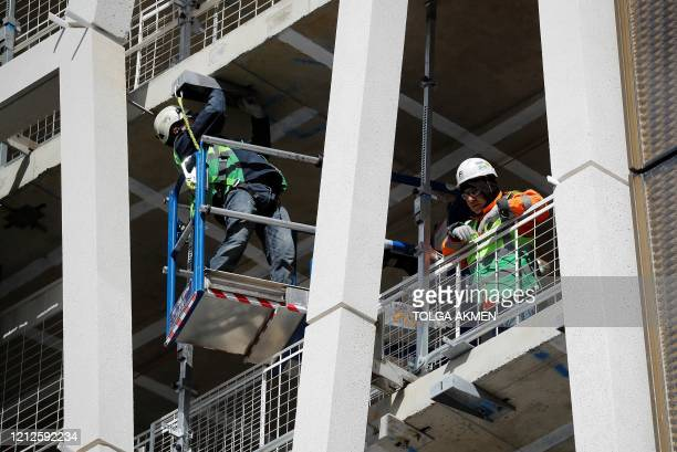 Workers in a hard hats work on a building construction site in central London on May 11 as life in Britain continues during the nationwide lockdown...