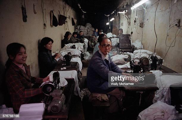 Workers in a Poorly-Lit Sweatshop