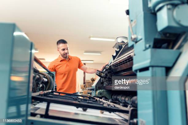 workers in a printing factory - printing press stock pictures, royalty-free photos & images