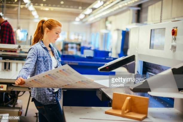 workers in a printing factory - printing plant stock pictures, royalty-free photos & images