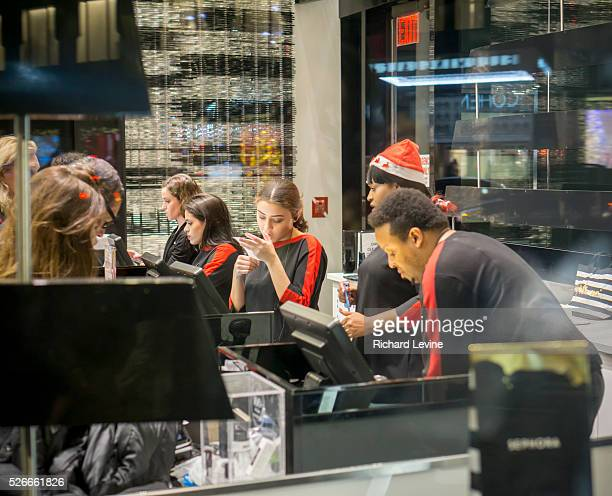 Workers in a Sephora store in New York on Tuesday, December 22, 2015.