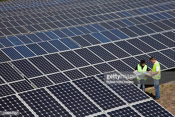 workers in a solar power plant - solar equipment stock pictures, royalty-free photos & images