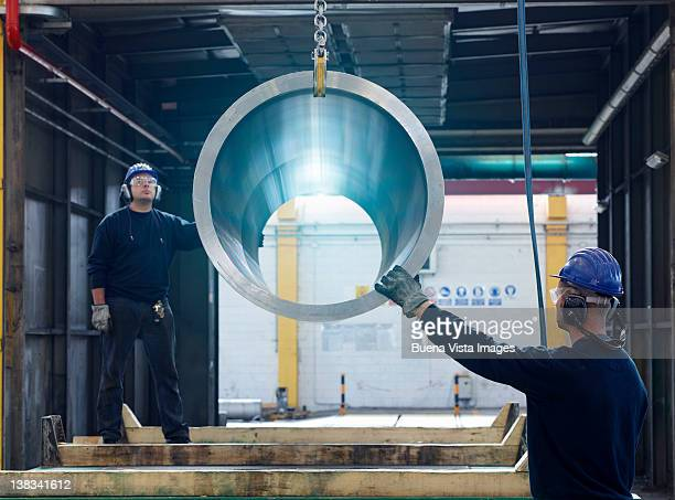 workers in a steel factory - metal industry stock pictures, royalty-free photos & images