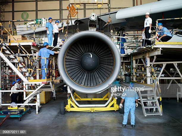 Workers in aviation maintenance facility