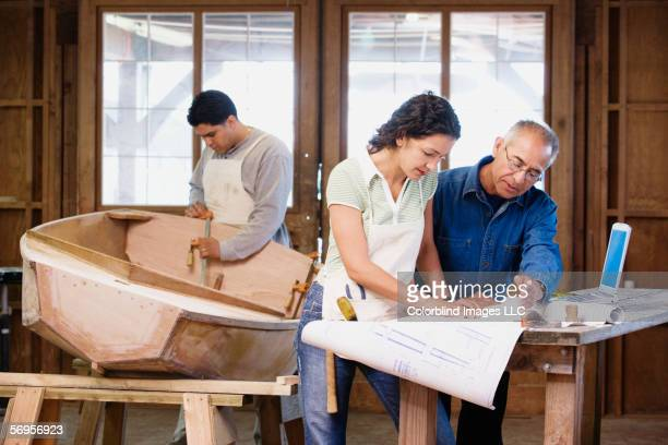 Workers in boat making workshop