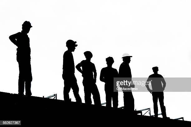 workers in b/w - crmacedonio fotografías e imágenes de stock