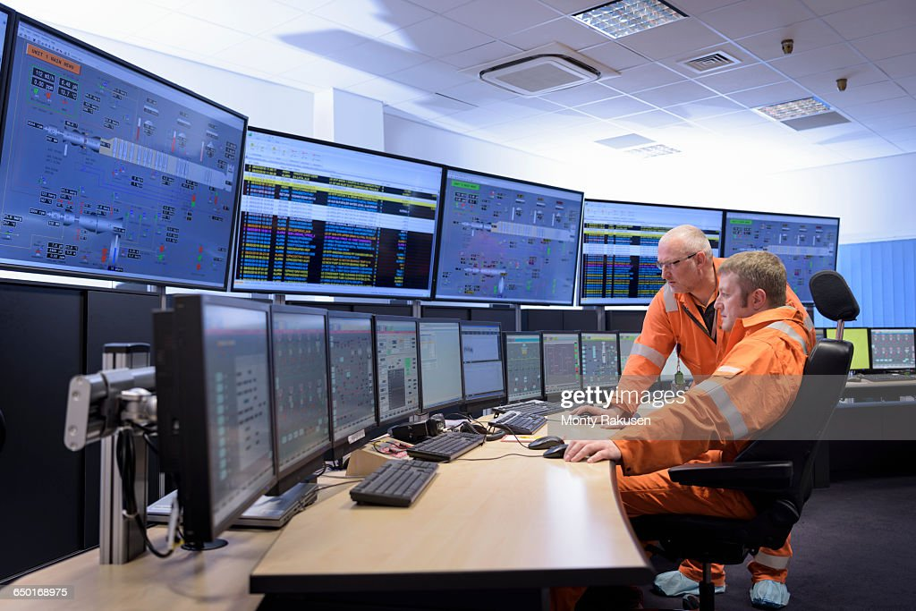 Workers in control room of gas-fired power station : Stock Photo