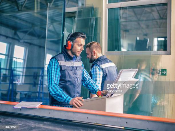 workers in factory - metallic look stock pictures, royalty-free photos & images