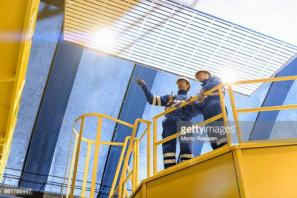 workers in generating hall in hydroelectric power station, low angle view - power station stock pictures, royalty-free photos & images
