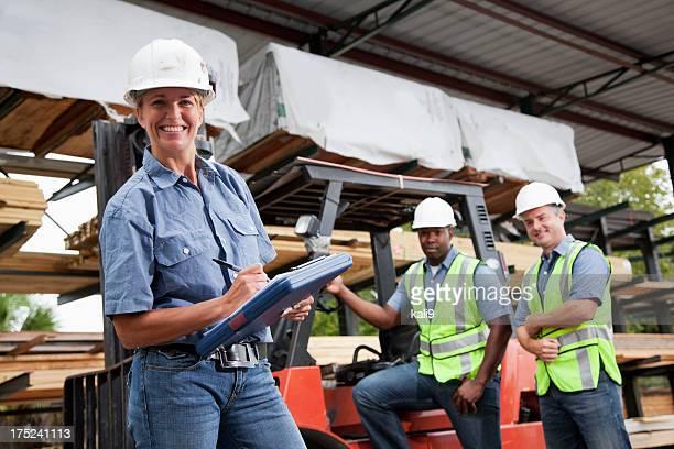 Workers in lumberyard