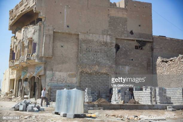 Workers in masonry work for the reconstruction of ruined houses in the old town in Mosul on April 24 2018 in MOSUL IRAQ
