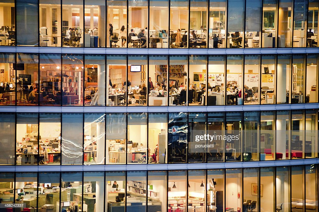 Workers in modern office building : Stock Photo