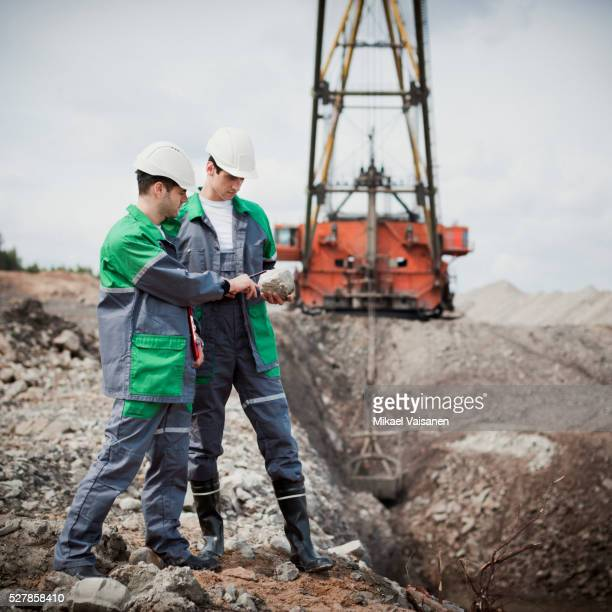 workers in open-pit mine - geology stock pictures, royalty-free photos & images