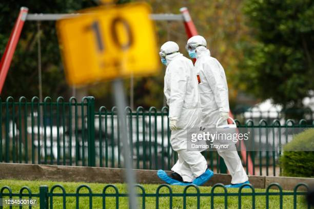 Workers in personal protective equipment are seen entering the Flemington Towers Government Housing complex on July 06 2020 in Melbourne Australia...