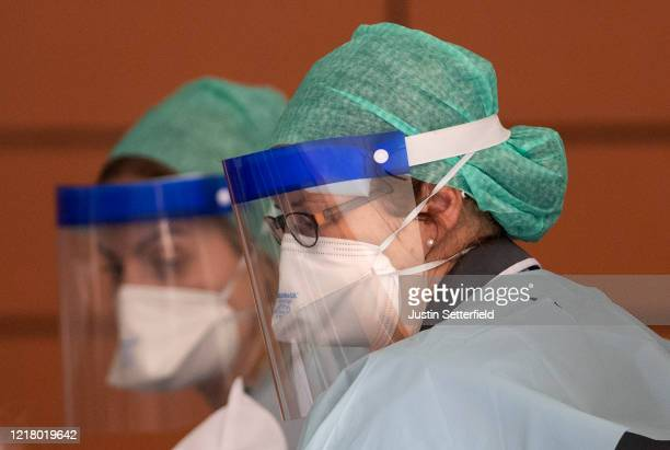NHS workers in PPE attend to a patient at St Thomas' Hospital on April 10 2020 in London England Public Easter events have been cancelled across the...