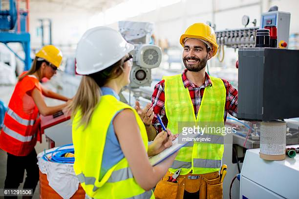 workers in pvc factory - safety stock pictures, royalty-free photos & images