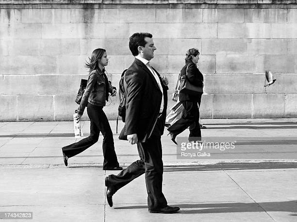 Workers in suits, executives, black and white candid street photography, London UK, rush hour
